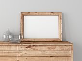 Horizontal wooden Frame Mockup close up on modern commode with glass decor