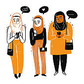 Muslim women gathered together Use the smart phone