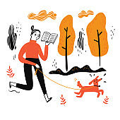 The woman walking dog reading a favorite book
