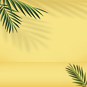 Abstract yellow gradient bacground with palm leaves. Vector