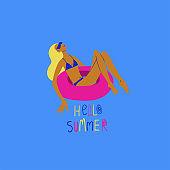 Sunbathing woman on the rubber swimming circle