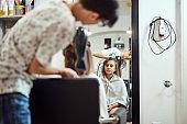 Hairdresser cutting hair in a salon.