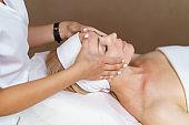 Facial massage beauty treatment.