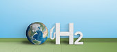 H2 Gas Pump station icon besides a globe - 3d illustration