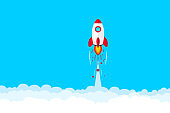 Rocket launch. Space rocket launch. Rocket flying in clouds. Successful startup business concept. New project start up. Creative or innovative idea. Launching new product or service. Rocket taking off