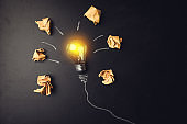 papers and light bulbs on board. Create idea concept