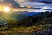 time change above the mountainous rural landscape