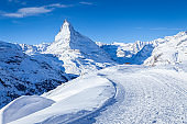 Hiking path in front of the Matterhorn in the morning light in winter