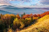 mountainous countryside in autumn at sunrise