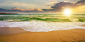 sea tide on a cloudy sunrise