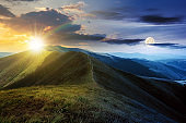 day and night time change above mountain landscape