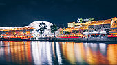 Clarke Quay night club party area of Singapore with river in front