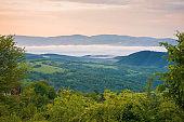 mountainous rural landscape at sunrise in summer