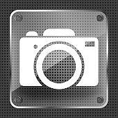 Glass photo camera icon on a metallic background