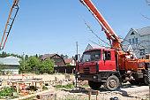 concrete pump on the site construction of foundation slab