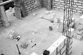 Black and white photo of interior of country house under construction