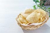 Potato chips (Potato crisps) on wooden table