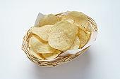 Potato chips (Potato crisps) on white background