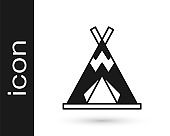Black Traditional indian teepee or wigwam icon isolated on white background. Indian tent. Vector