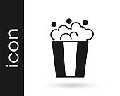 Black Popcorn in cardboard box icon isolated on white background. Popcorn bucket box. Vector