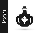 Black Bottle of maple syrup icon isolated on white background. Vector