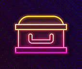 Glowing neon line Coffin with christian cross icon isolated on black background. Happy Halloween party. Vector
