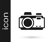 Black Photo camera icon isolated on white background. Foto camera. Digital photography. Vector