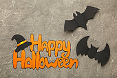 Halloween composition with bats on grey background. View from above.