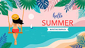 Summer scene, young woman sitting on swing on the beach, looking at the sea. Hello summer background and banner