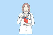 Doctor cardiologist and healthy heart concept