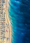 Mediterranean sea. Aerial view on beach and umbrellas. Vacation and adventure. Beach and blue water. Top view from drone at beach and azure sea. Travel and relax image