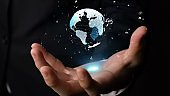 Human hand holding earth globe holographic technology
