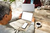 Senior african american woman using digital tablet at home