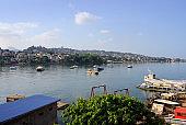 Murray Town skyline and boats in Aberdeen Creek, Freetown, Sierra Leone