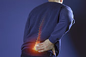 Man suffering from back pain. Health and medical insurance concept.