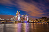 Tower Bridge with dramatic sky at night in London, England, UK