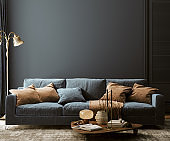 Modern home interior mock-up with dark blue sofa, table and decor in living room
