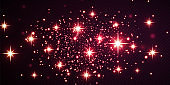 Christmas festive background of light confetti and small shining red lights, on a transparent black background. Glittering red texture. Christmas effect for luxury greeting rich card