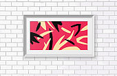 Abstract painting in a realistic frame. The poster is hanging on a brick wall.