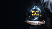 Human hand holding earth 5G globe holographic technology