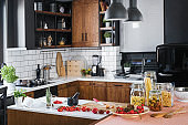 Modern home kitchen interior with fresh ingredients ready for cooking