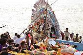 Durga idol immersion on river