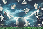 Banknotes raining on the soccer field. Business in the sports world