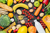 Vegetables, fruits assortment frame on dark wooden table. Vegetarian healthy food concept. Food and grocery shopping.