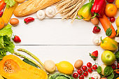 Vegetables, fruits assortment frame on white wooden background. Farmer table. Vegetarian healthy food concept. Food and grocery shopping. Free space