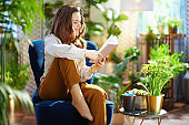 relaxed housewife with long wavy hair in house in sunny day