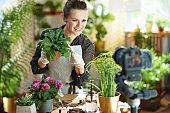 happy woman records gardening educational video tutorials