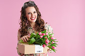 happy trendy female in floral dress on pink