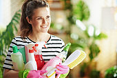 happy woman at home in sunny day doing household work