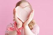 Closeup on girl on pink